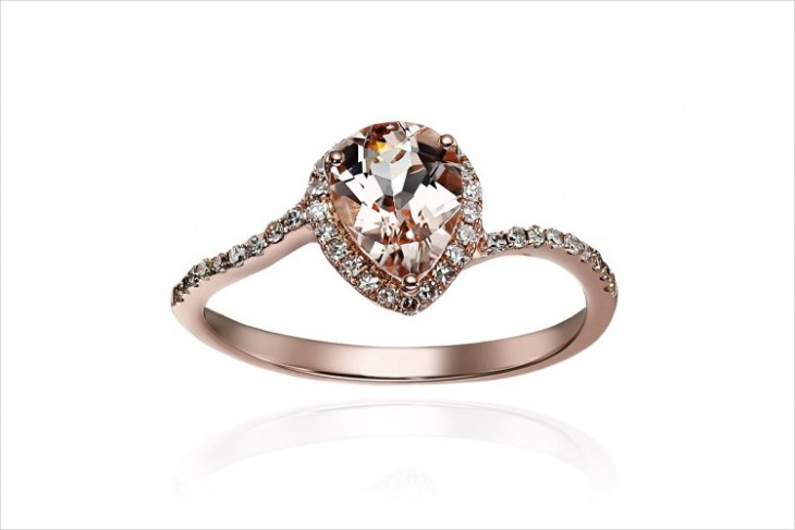 delicate pear shape engagement ring