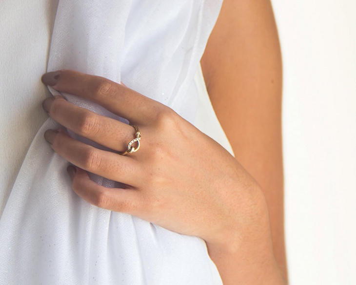 delicate knot engagement ring