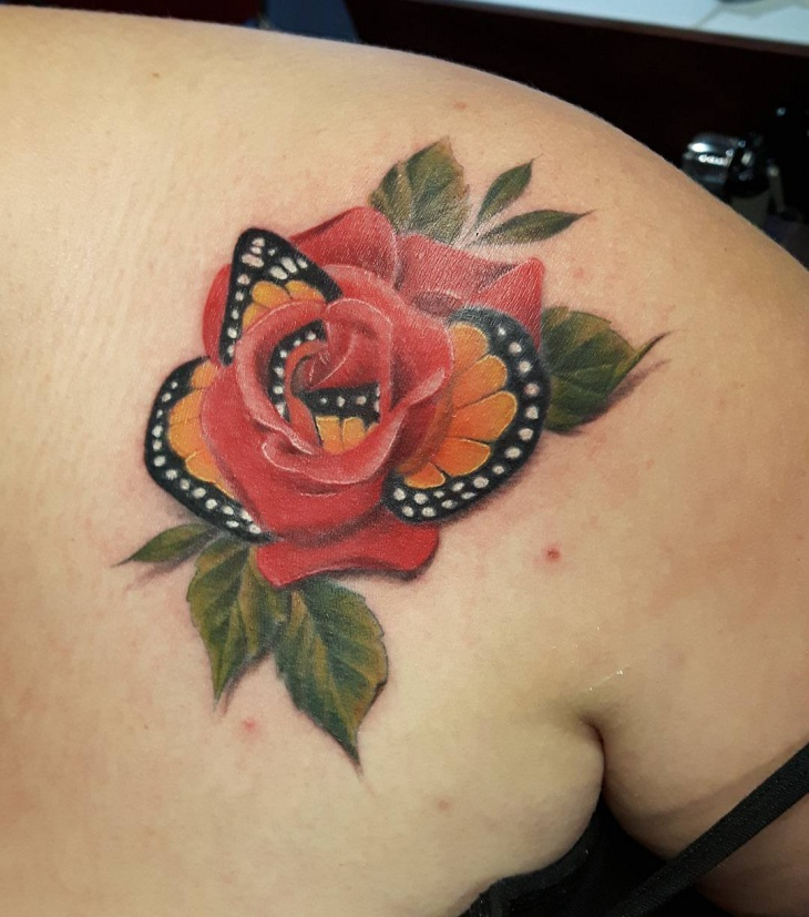 rose and butterfly tattoo on shoulder