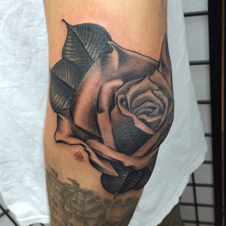 rose tattoo on elbow