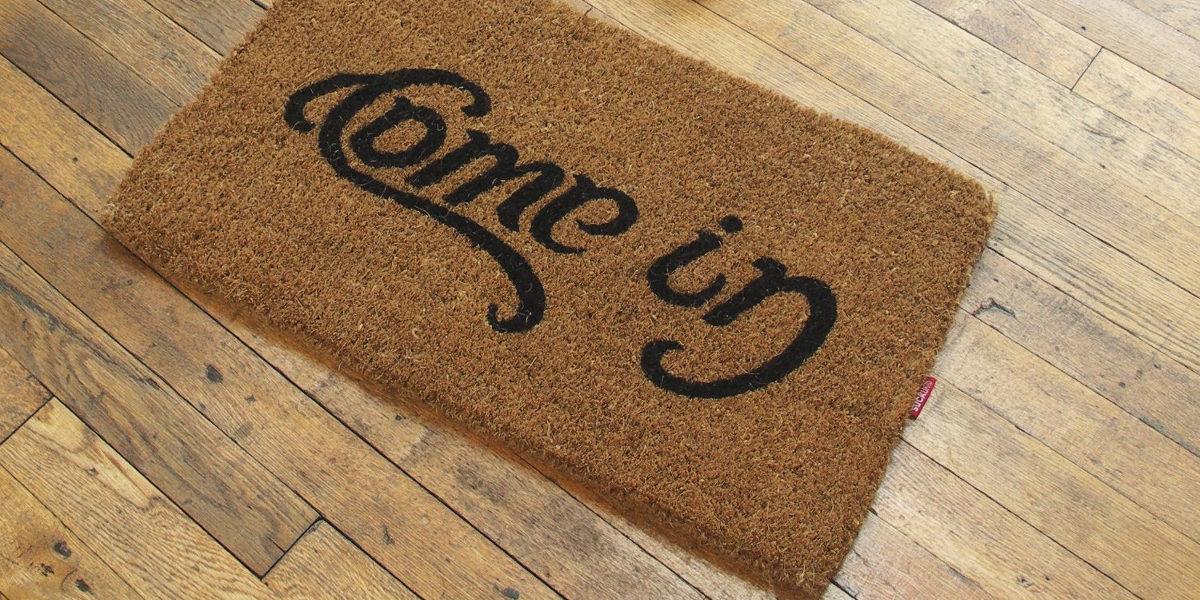 welcome go away ambigram doormat