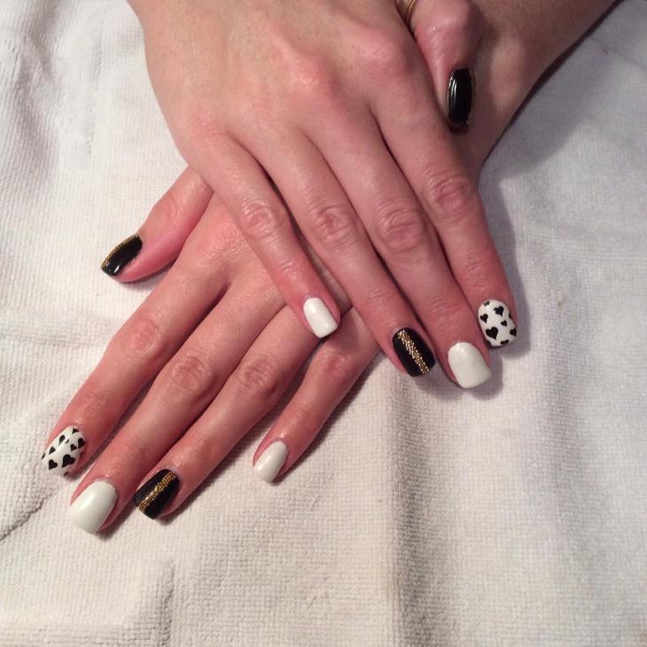 black and white heart nail design