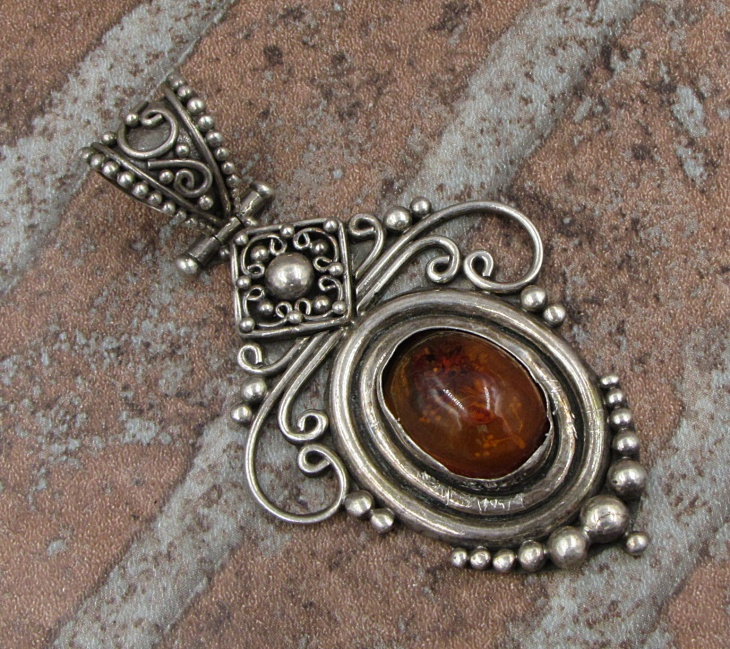 unique amber pendant design