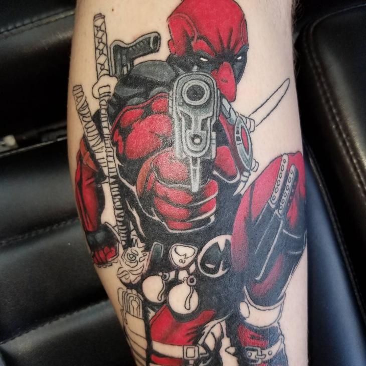 weird deadpool tattoo