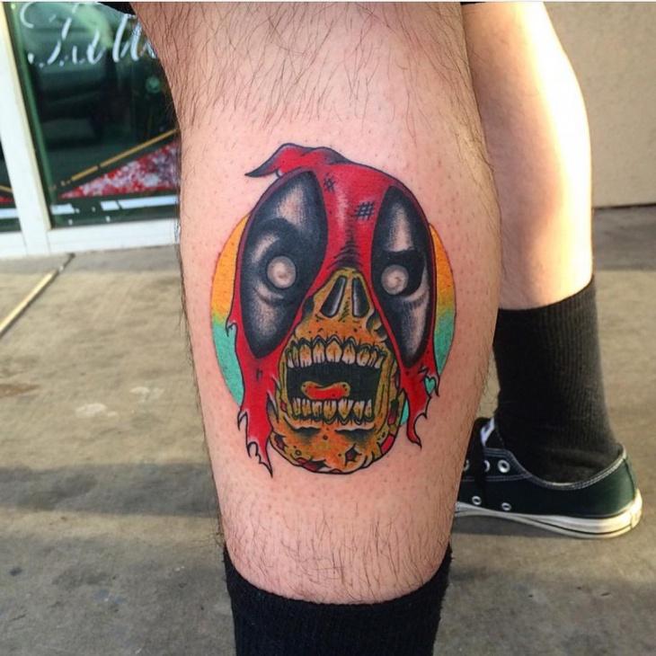 deadpool tattoo on leg