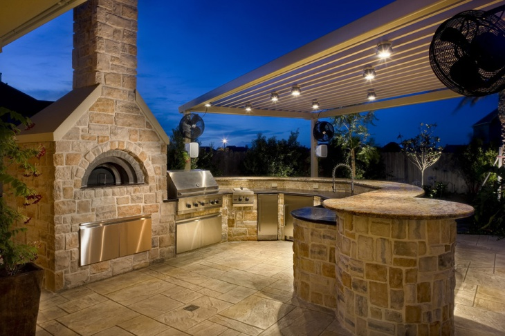 Stone Outdoor Kitchen Island with Fireplace