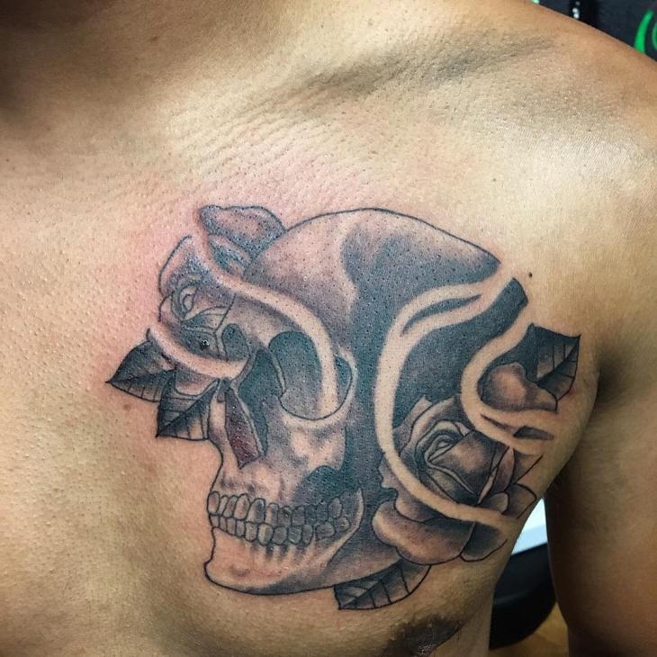 skull chest tattoo design idea