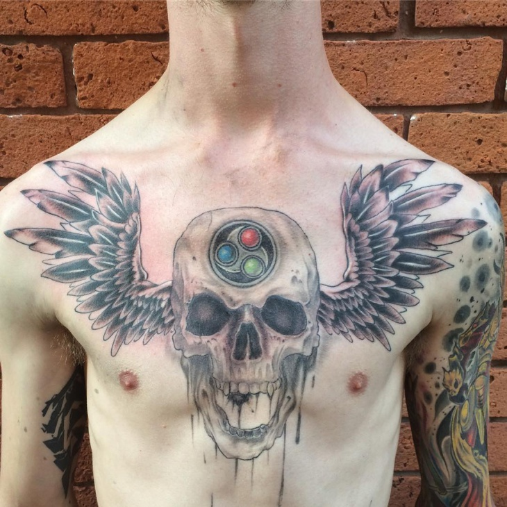 skull and wings tattoo for men