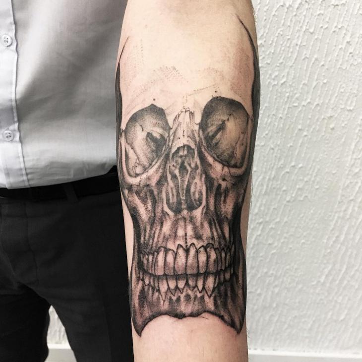 skull tattoo on forearm