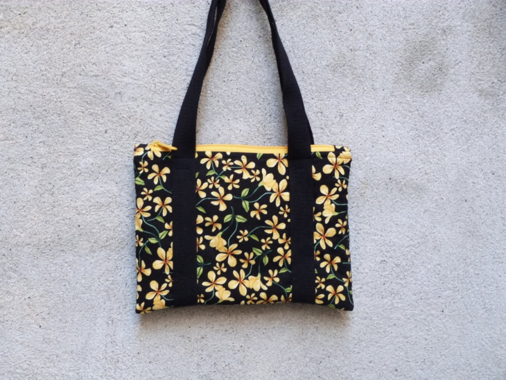 yellow and black floral handbag