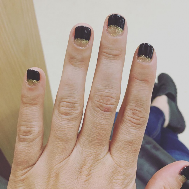 black and gold half moon nails