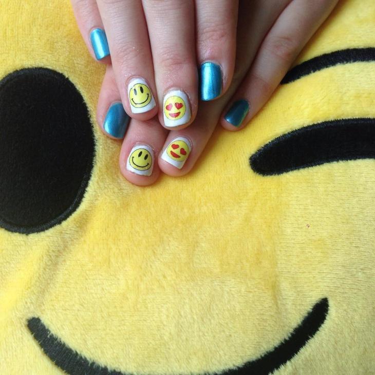 blue and white emoji nails