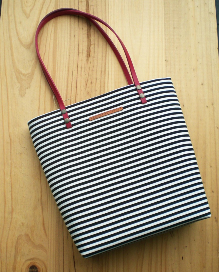canvas handbag with leather straps