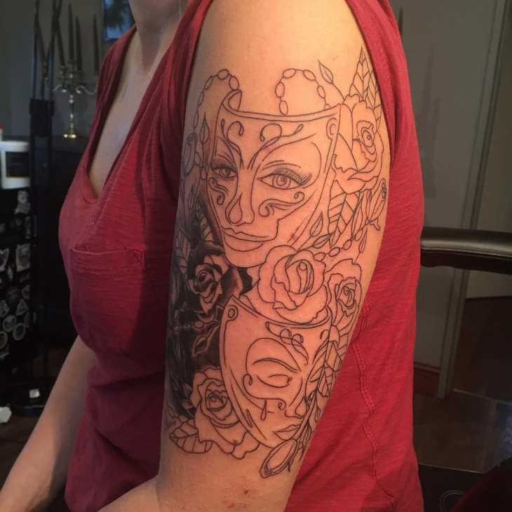 mask tattoo on sleeve