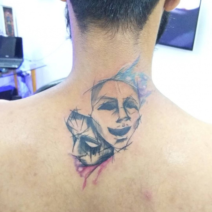 mask tattoo on back