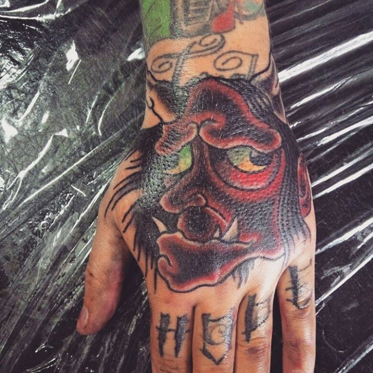 scary mask tattoo on palm