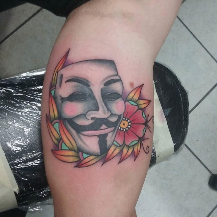 unique mask tattoo design