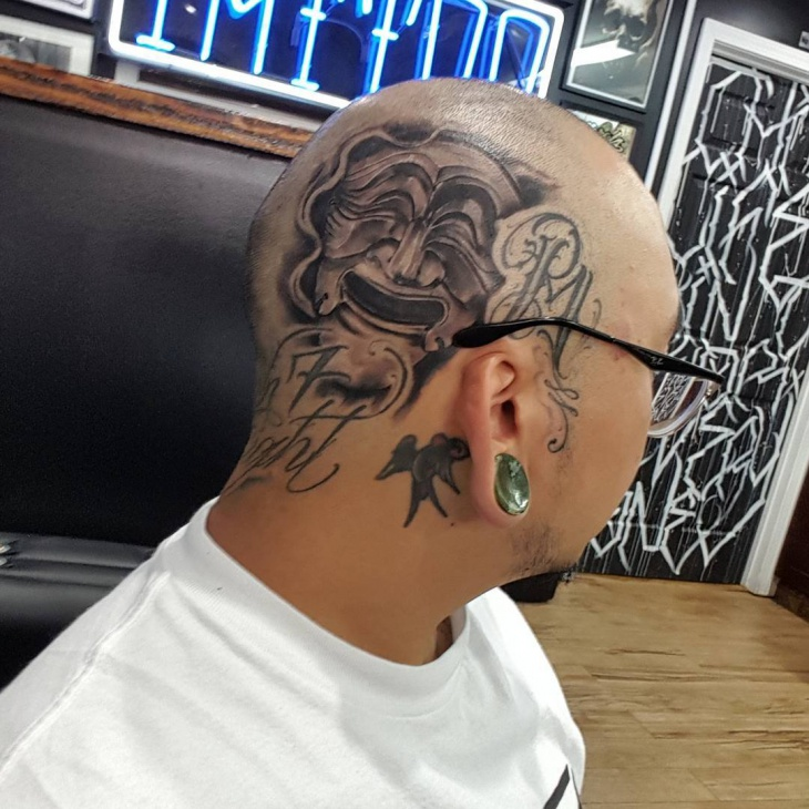 madsk tattoo on head