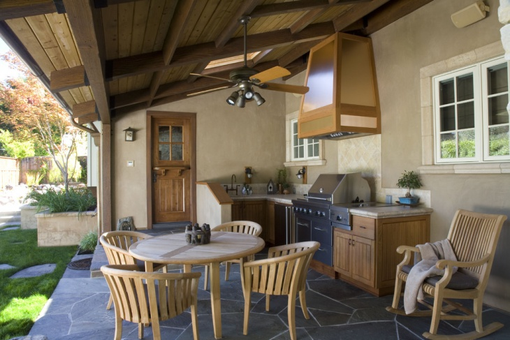 outdoor kitchen with walnut cabinetry