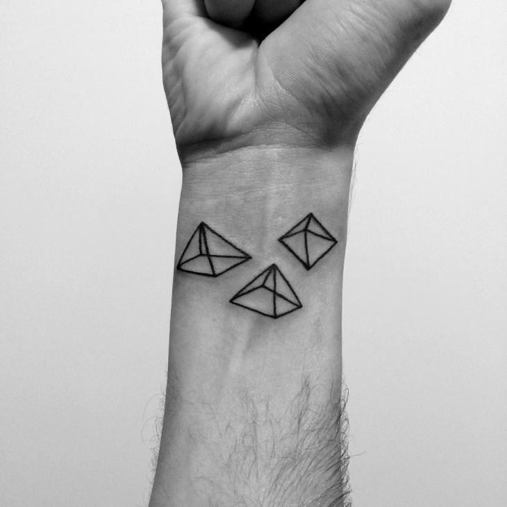 pyramid tattoo on wrist