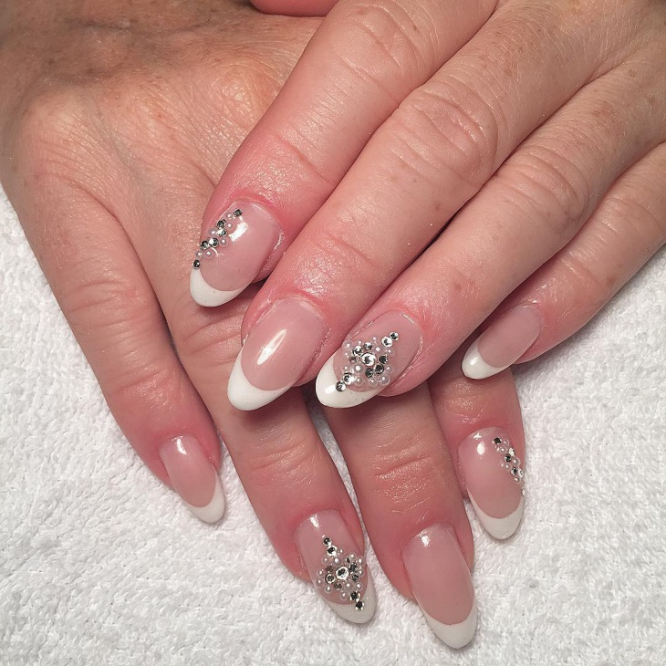 french tip nail art design with rhinestones