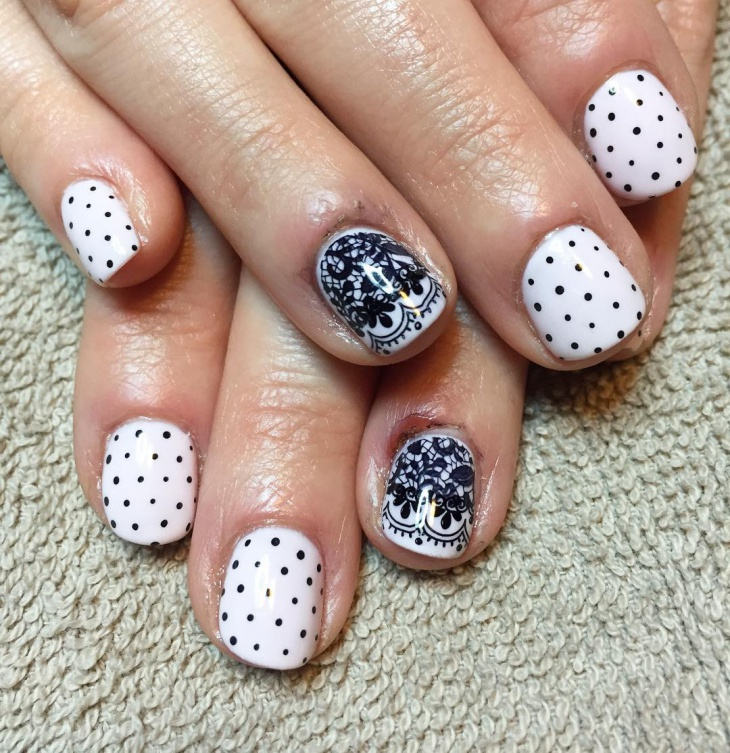 black and white polka dot nail design