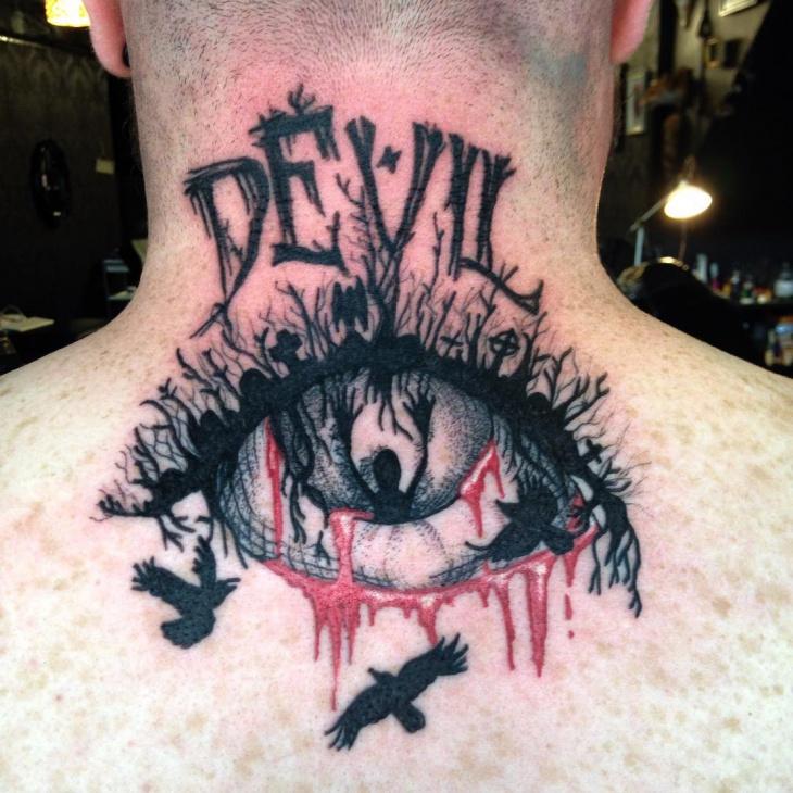 devil eye graveyard tattoo