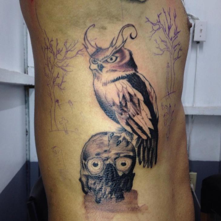 scary owl tattoo design