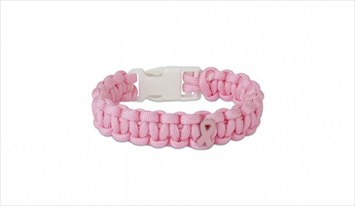 pink paracord bracelet with white buckle