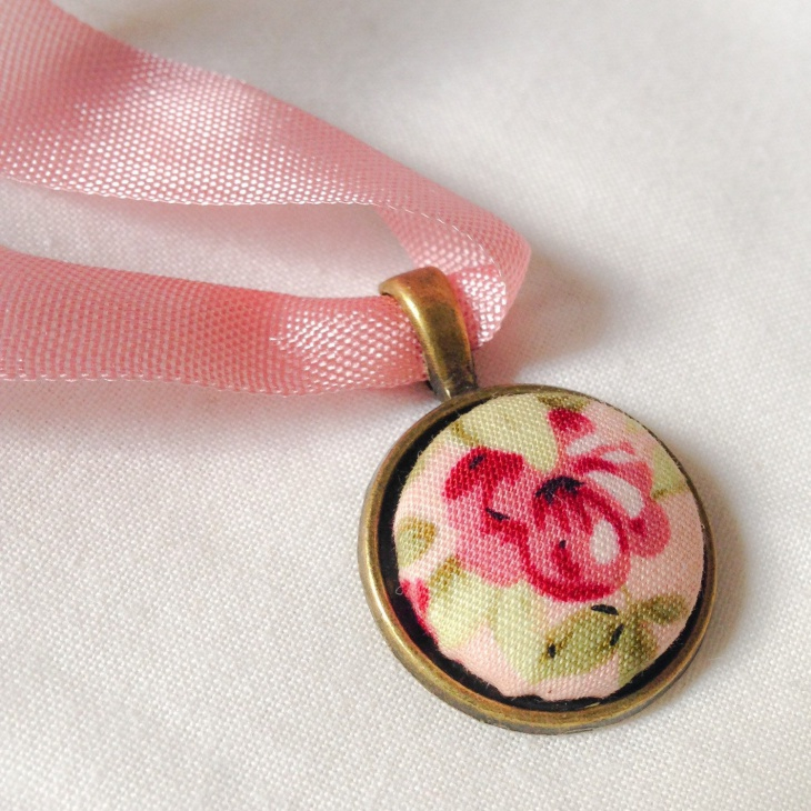 pink fabric floral pendant