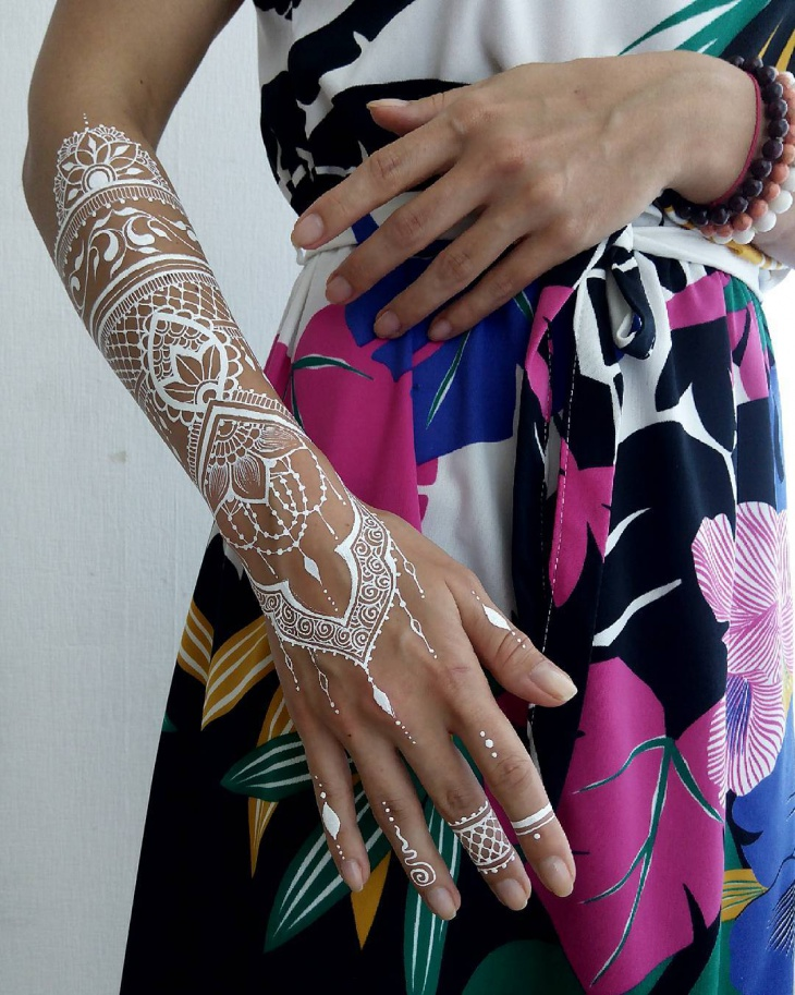 white henna hand tattoo design