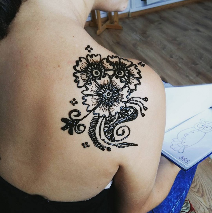 henna flower shoulder tattoo