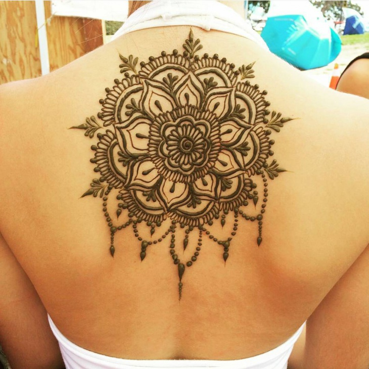 henna tattoo design on upper back