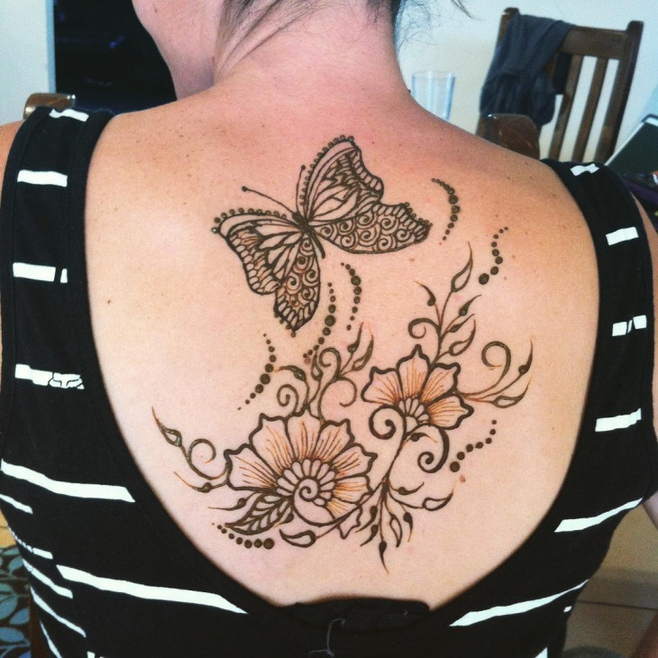 butterfly henna tattoo on back