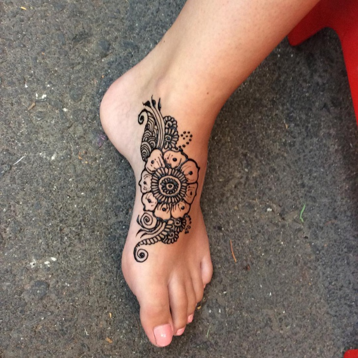 henna flower foot tattoo