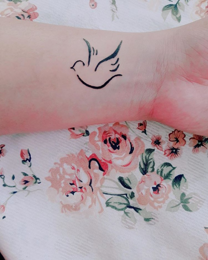 flying bird henna tattoo design