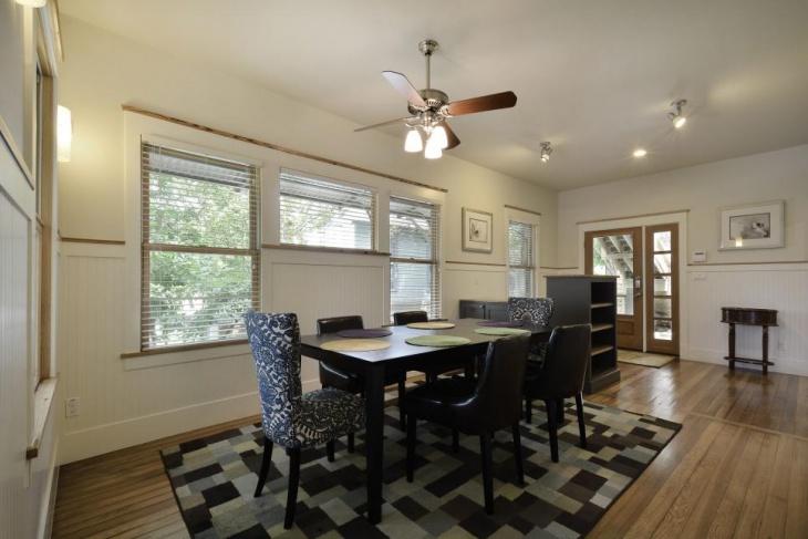 Black Dining Table Geometric Carpet Idea