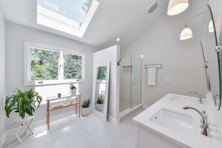 spacious white bathroom skylight