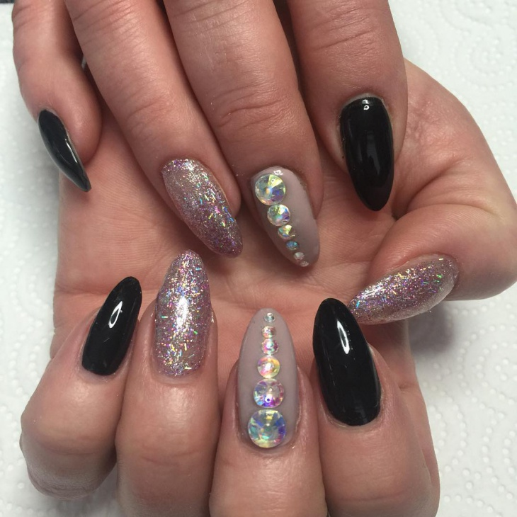 stiletto acrylic nail design with rhinestones
