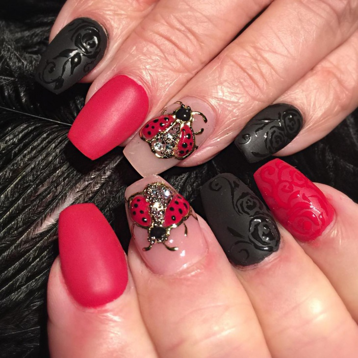 red and black acrylic nail design