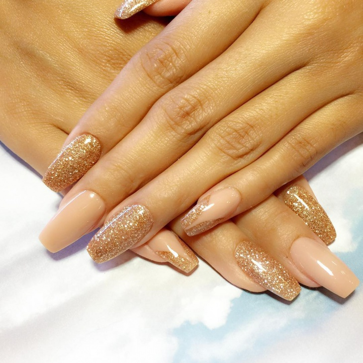 gold glitter acrylic nail design