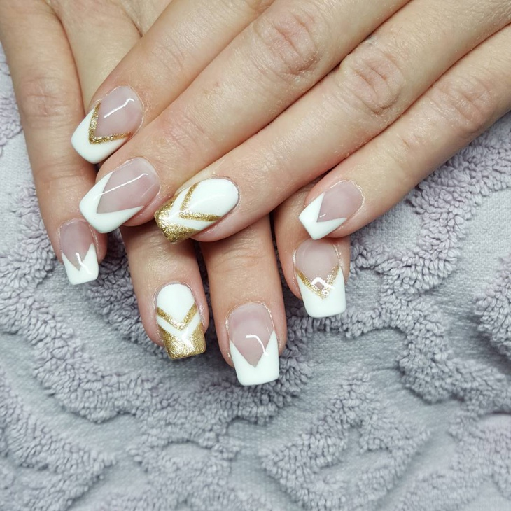 white and gold acrylic nail design