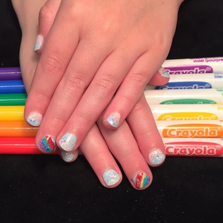 short rainbow glitter nail design