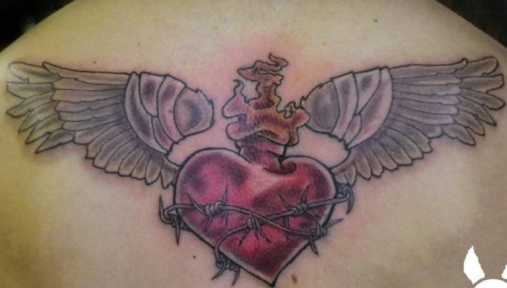 scared flaming heart tattoo