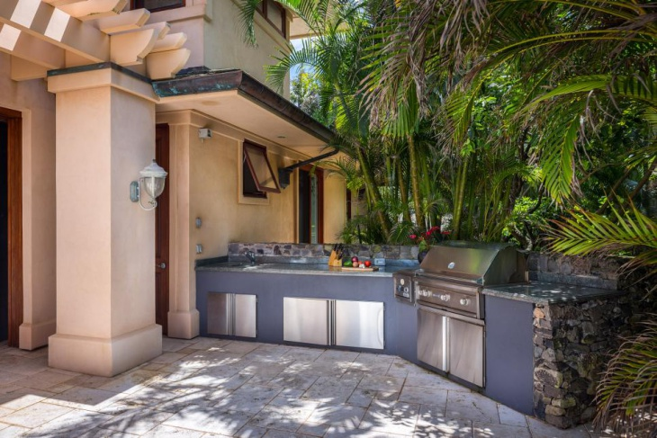 modern outdoor kitchen with stainless steel door