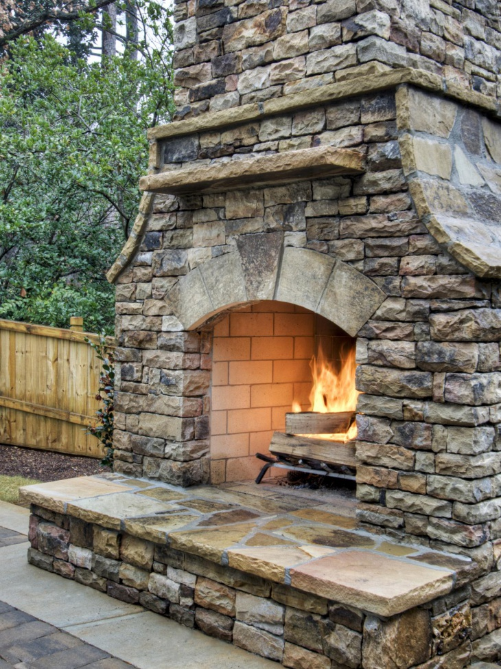 stacked stone outdoor fireplace design