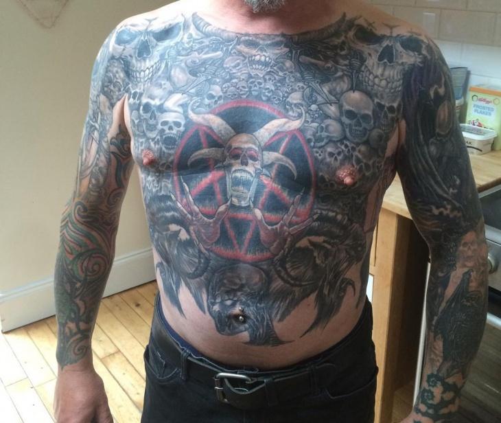 evil skull tattoo on chest
