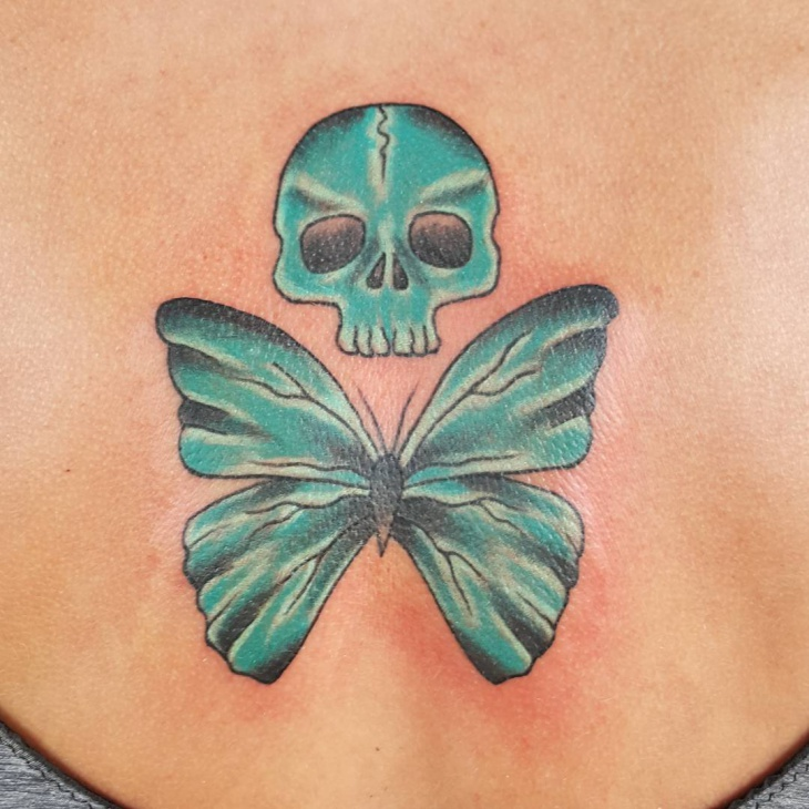 blue skull and butterfly tattoo