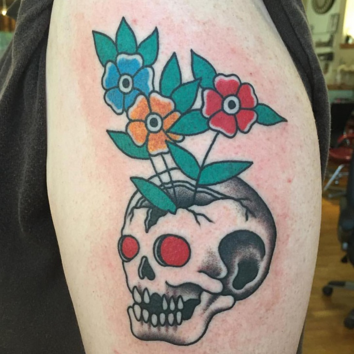 traditional skull with flower tattoo