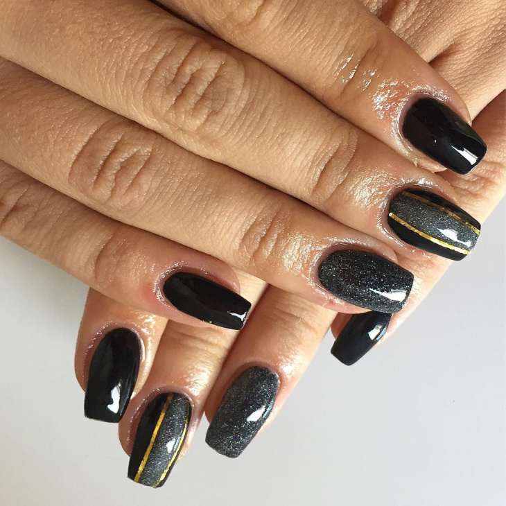 golden stripes black gel nail art